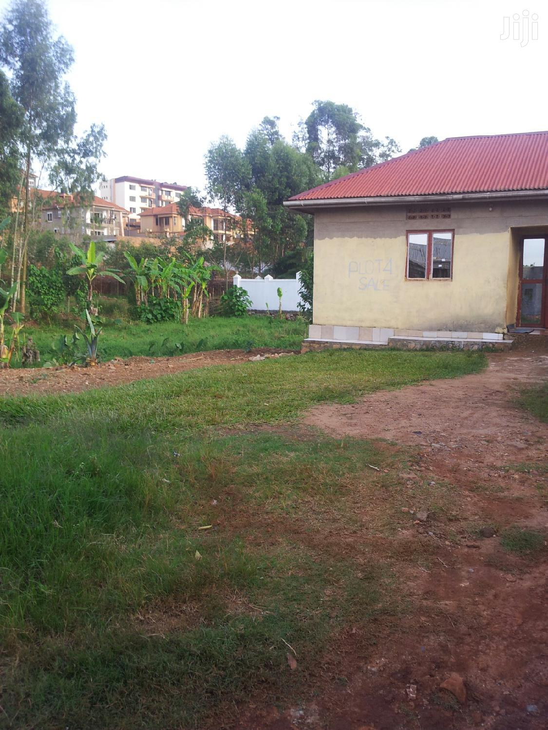 Komamboga Plot for Sale With House