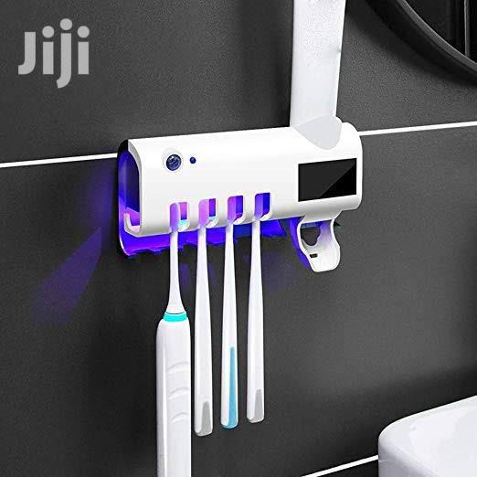 Toothpaste Dispenser And Utra Violet Tooth Brush Holder.