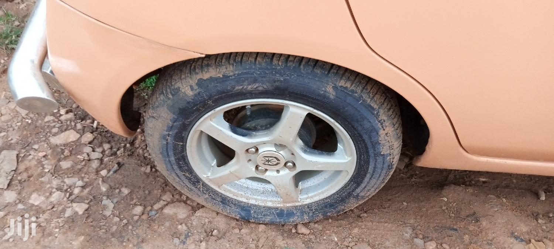 Archive: Nissan March 1998 Orange