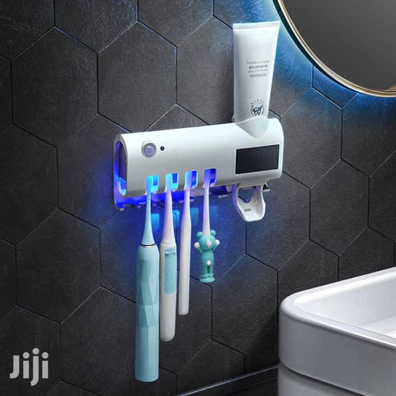 Toothpaste Dispenser Brush Holder And Disinfector