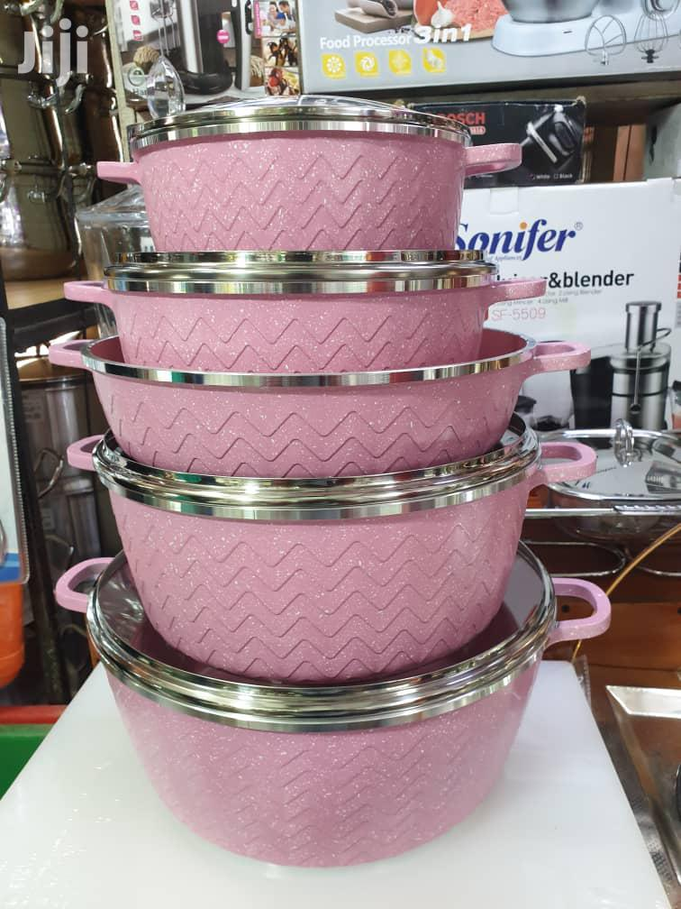 A Set Of 5 Pink Cooking And Serving Non Stick Pots
