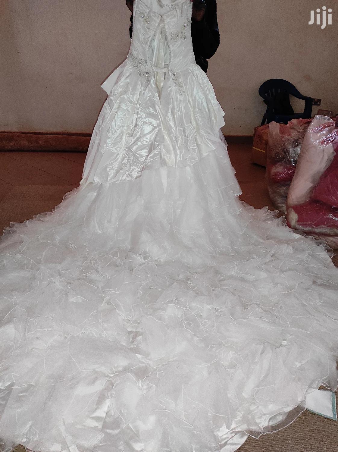 Its Made In London Intunzuri Ivory Dress Size 12 | Wedding Wear & Accessories for sale in Kampala, Central Region, Uganda