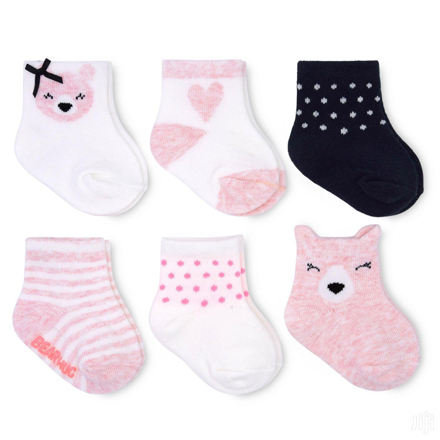A Packet of Four Baby Body Socks