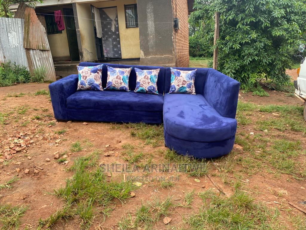 L Shape Sofas Blue With Flower Pillows